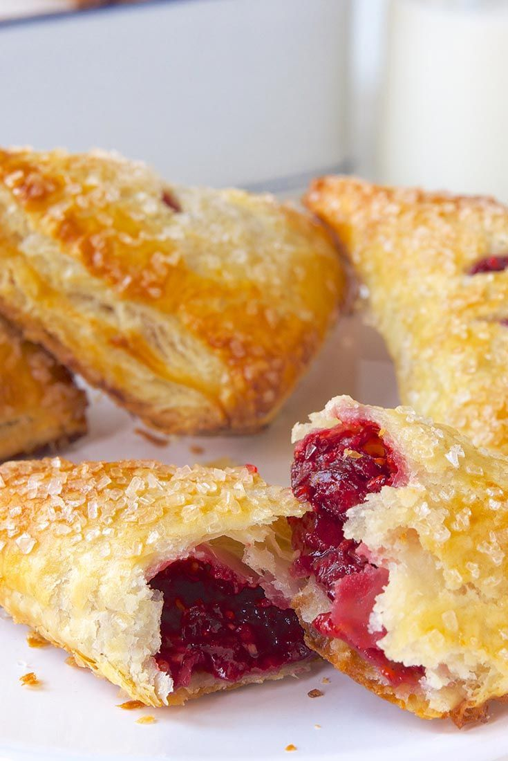 Ultra-flaky, buttery pastry encloses a tart-sweet, homemade raspberry filling in these tempting turnovers. Raspberry Puff Turnovers