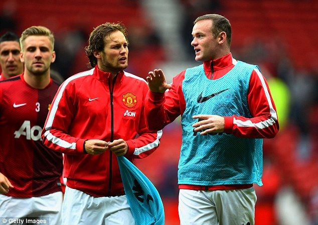 Blind listens to advice from his captain Wayne Rooney ahead of his side's home fixture aga...