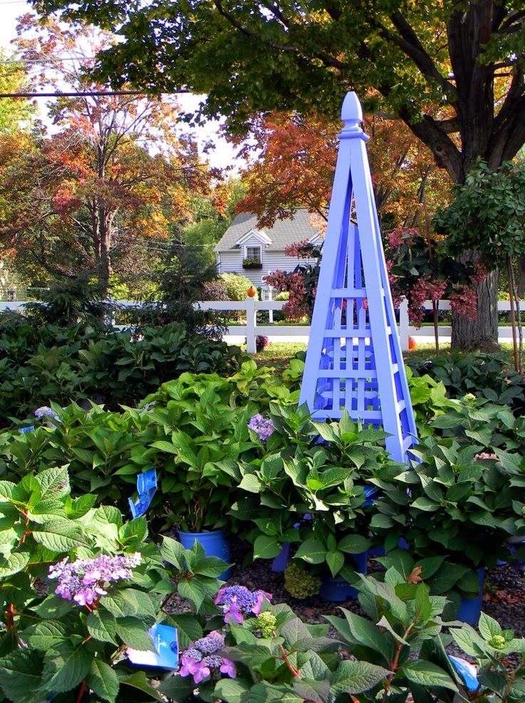 222 best wooden garden obelisks images on pinterest for Garden obelisk designs
