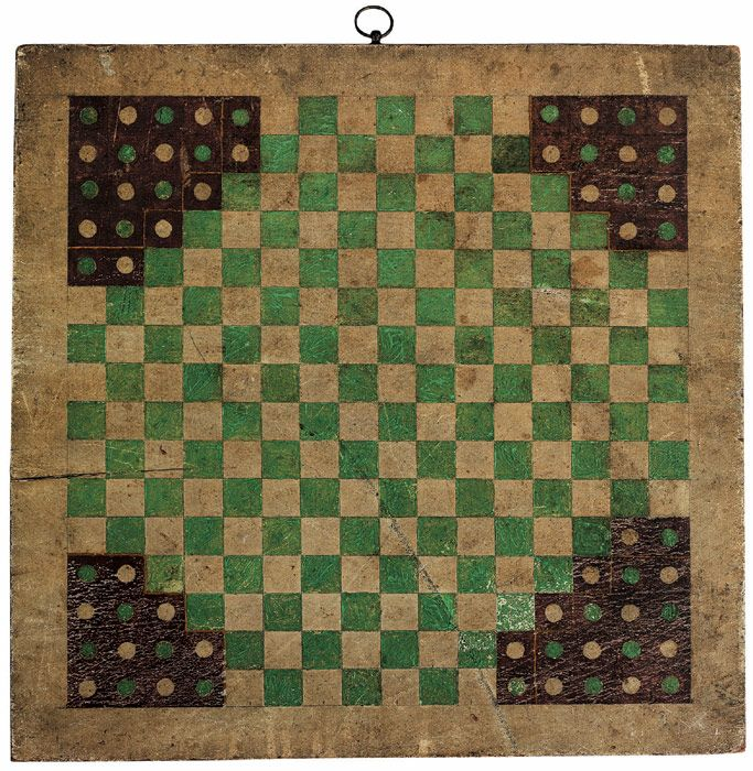 "Looks like our Chinese checkers game board.  Played for hours...  Halma game board. 19th century painted wood. Halma (from the Greek word ἅλμα meaning ""jump"") is a board game invented in 1883 or 1884 by an American thoracic surgeon at Harvard Medical School, George Howard Monks. The inspiration was an English game called Hoppity, which was devised in 1854."