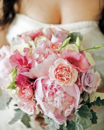 Peonies, roses, and lisianthus in pale shades of pink make up this