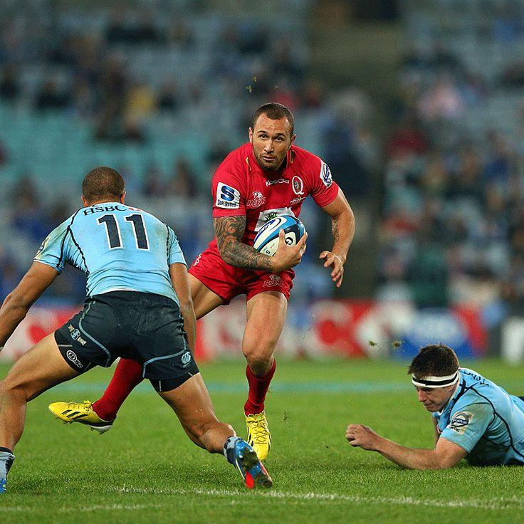 Super Rugby Round 20 | The Reds' Quade Cooper steps past Jed Holloway and Peter Betham. | Getty Images