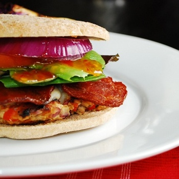 Southwest Turkey Bacon Burger...  This decadent, quarter pound, spicy bacon cheeseburger has everything you could ask for in a turkey burger recipe. Loaded with flavor, fiber and a lot less fat and calories than you'd find in the restaurant version.