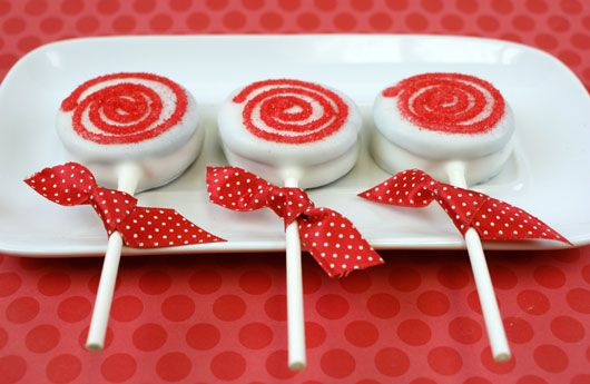 Oreos dipped in white chocolate (put on sucker sticks) w/red frosting to look like peppermints