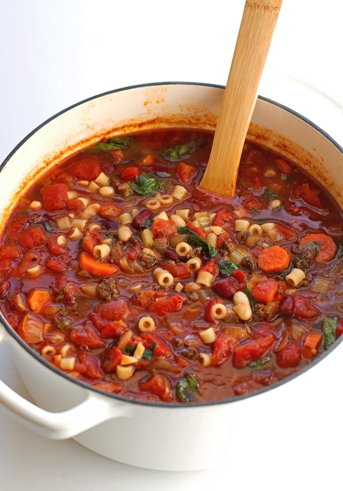 Copycat recipe for Olive Gardens hearty and light pasta e fagioli soup. This soup quick and easy to make. With tomatoes, beans, carrots, celery, and basil.