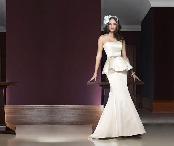 Paris  Striking silk duchess satin fishtail wedding gown with detachable peplum and handcrafted beaded belt.