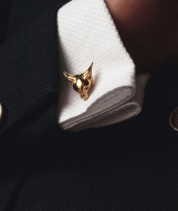 Lamorne Cufflinks A set of cufflinks with a motif of a cat playfully biting into a shirt cuff. The surfaces shaping the image of the cat and its broad, slightly pointed ears make a perfect composition with the cuffs creating an elegant element of an attire designed for both men and women. #cufflinks #cat #finejewellery #annalubomirska