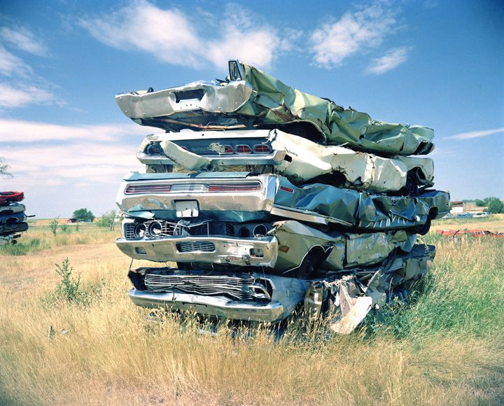Five crushed cars stacked | Millennium Images Library