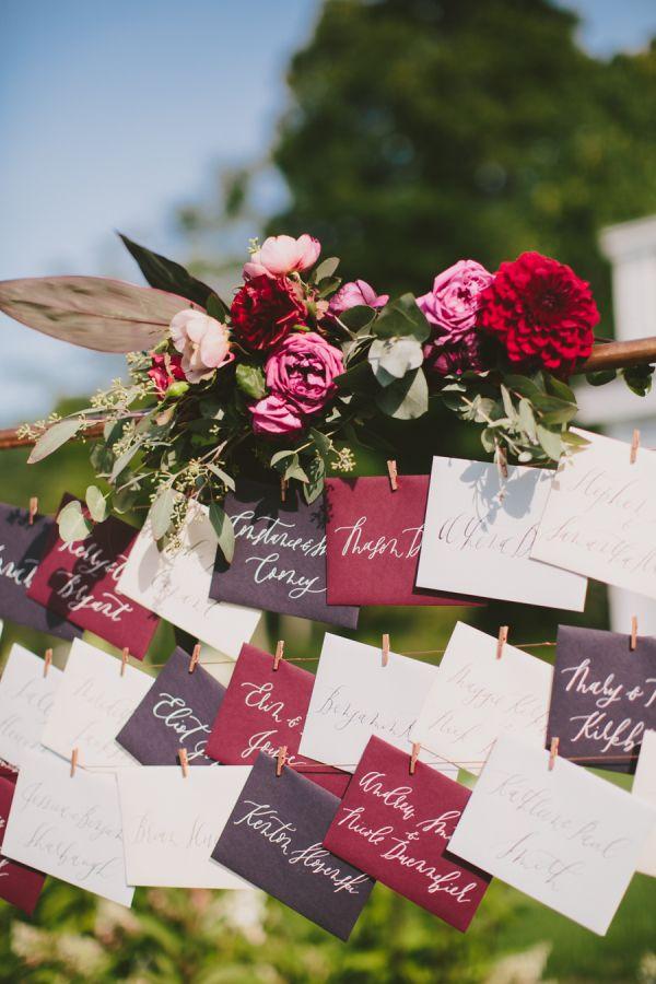 Deep burgundy and purple wedding escort cards: http://www.stylemepretty.com/2015/11/18/elegant-autumn-barn-wedding-in-maine/   Photography: Henry + Mac - http://henryandmac.com/