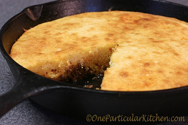 cornbread taco pie layer in cast iron: Cook seasoned Ground meat and onions, add taco seasoning cook according to directions, add one can of corn drained, top with shredded cheese, prepare jiffy box mix, top meat/cheese with corn bread, bake at 400   15-20 until golden.  cut like pie.    Cooked this last night....delicious & easy!! Topped with a little sour cream and shredded cheese =) Yum!!!