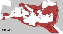 L'Empire byzantin (en rouge) et ses vassaux (en rose) à son apogée en 555, durant le règne de Justinien le Grand.