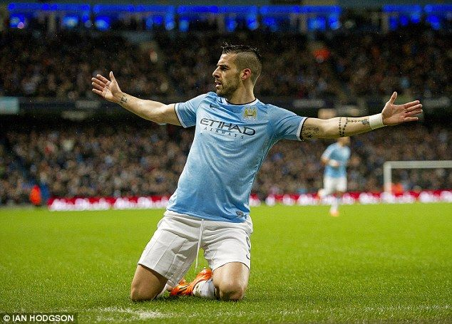 On-fire: Alvaro Negredo slides to celebrate scoring against West Ham where he netted a hat-trick