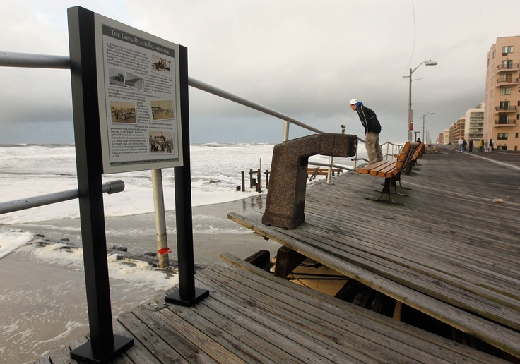 LONG BEACH, NY - OCTOBER 30: A section of an old boardwalk is seen destroyed by flooding from Hurricane Sandy on October 30, 2012 in Long Beach, New York.
