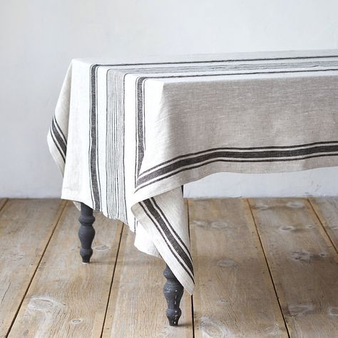 "Drape this striped cloth over the table for the feel of an elegant country picnic. This fine, 100% linen is woven in Lithuania.- 100% linen- Lithuania56""W, 98""L"