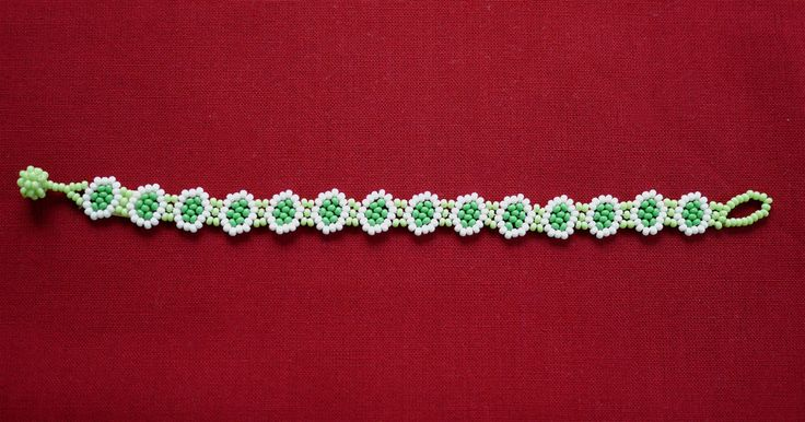 MEXICAN LITTLE FLOWERS BEADED BRACELET - WHITE & GREEN  ★ Mexican beaded bracelet, with a flower path in light green, white and medium green. It's simple to wear; it just easily rolls over your hand and is very comfortable. ★ This beaded work is made by Mexican families. ★ You can combine it with various styles!