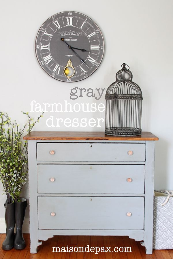 See a stunning update to an antique farmhouse dresser. In a soft, neutral color, this farmhouse dresser is a perfect complement to a modern room.