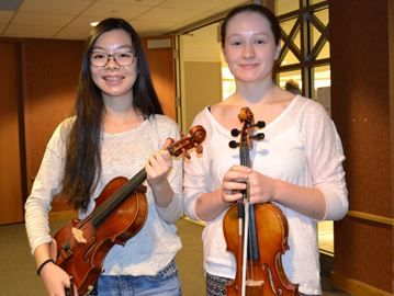 Huronia Symphony Orchestra program gives youth orchestra experience in Barrie - Serena Lai, left, and Hanna Fletcher are graduates of the Huronia Symphony Orchestra's youth program.