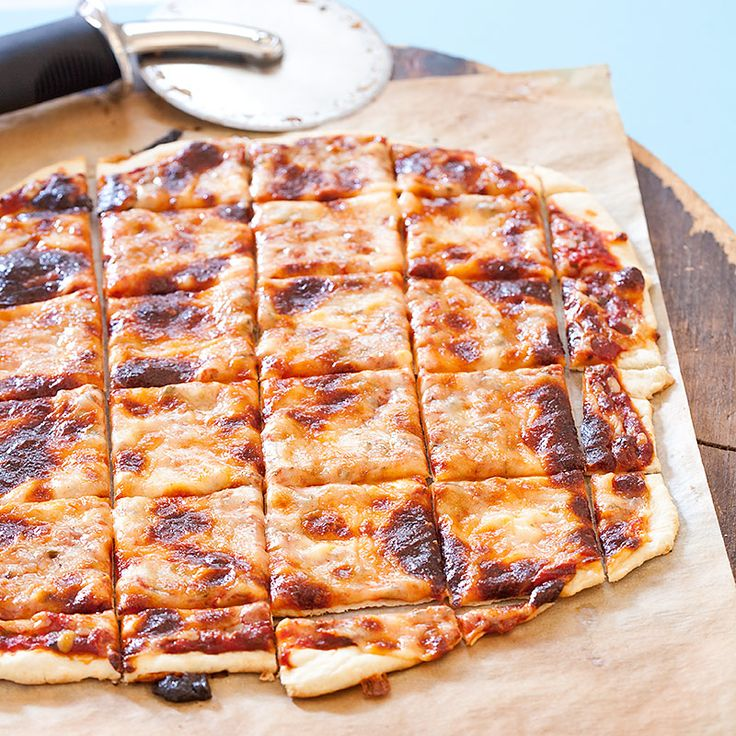 With its wafer-thin crust; thick, sweet tomato sauce; gooey Provel cheese; and signature square slices, St. Louis-style Pizza is unmistakable.