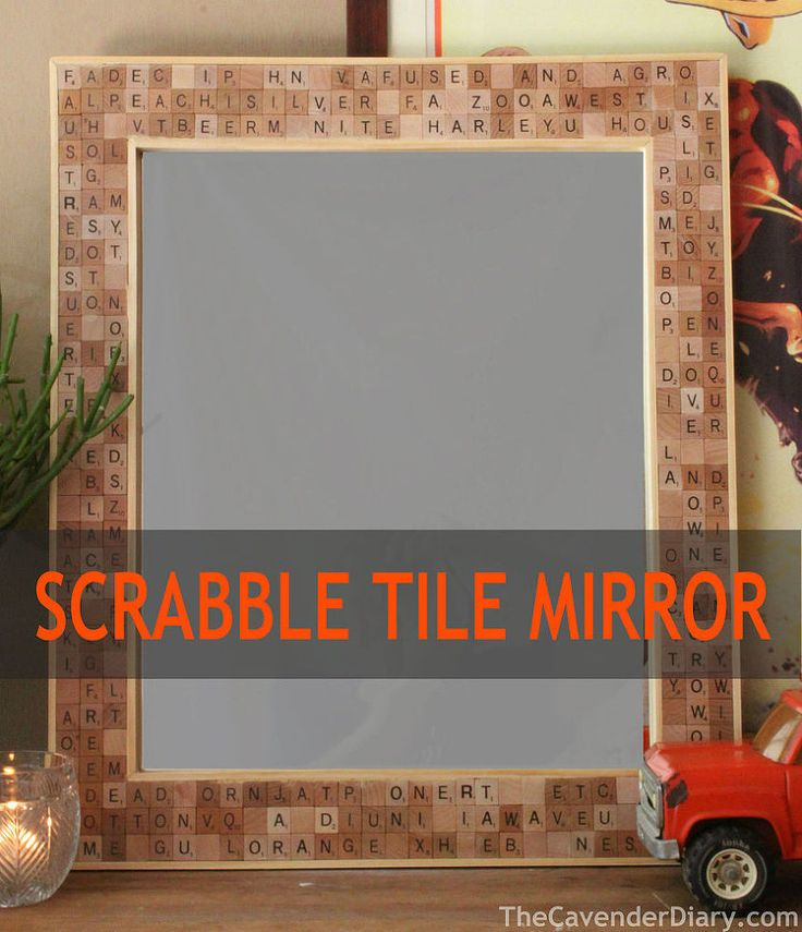 What a great idea! Use scrabble pieces as a frame for your mirror!