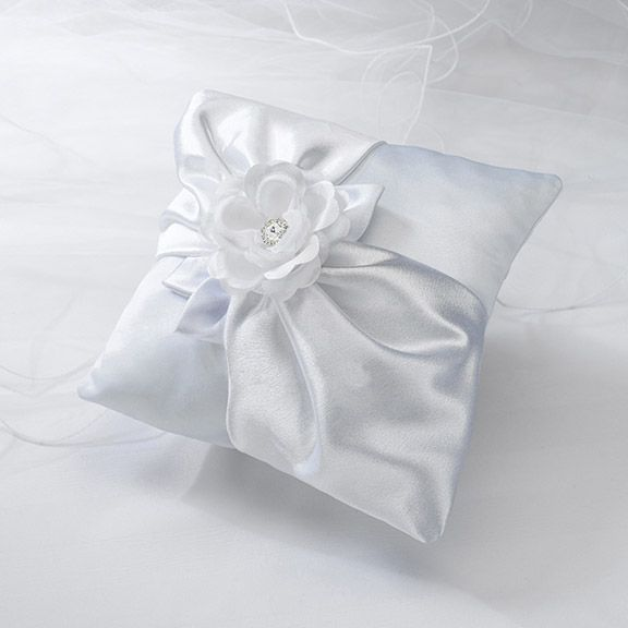I have no clue how someone could make this themselves, or how you feel about a giant flower being on the pillow, but I think this is my second favorite (next to the stacked pillows).