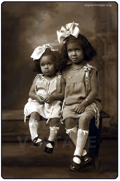"""budgetchic: """" Absolutely adorable! Two litle girls (I'm assuming their sisters) all dressed up in bows from head to toe! 1900's (please do not copy, download or alter this image without my permission,..."""
