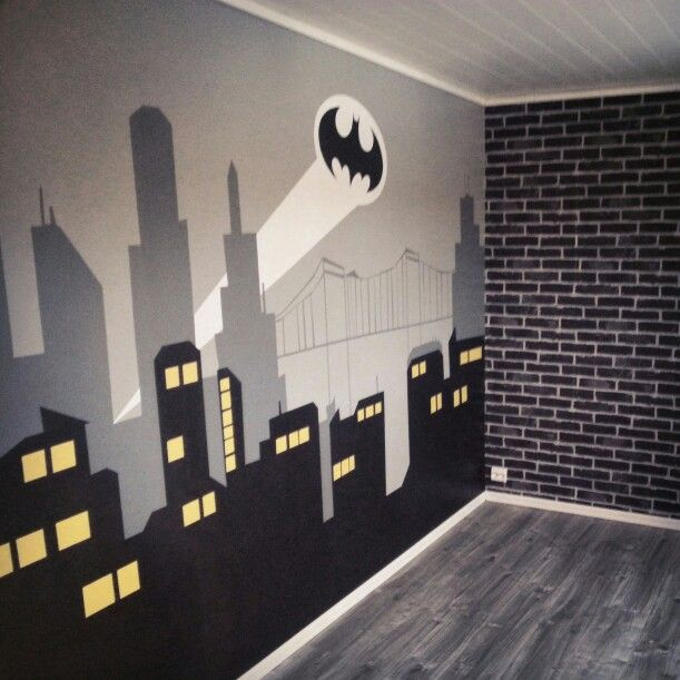 Bedroom with Gotham City mural and brick wallpaper for the Batman