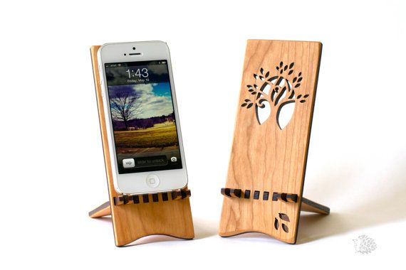 This beautiful cherry wood stand holds your phone while it charges. The stand is at the perfect angle for you to use your phone while it sits on your