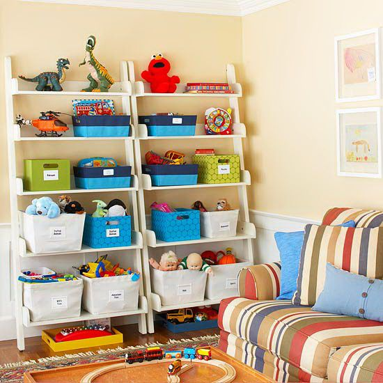 a shelving unit like this one stores toys and games within easy reach for kids as a safety measure anchor the shelves to the wall