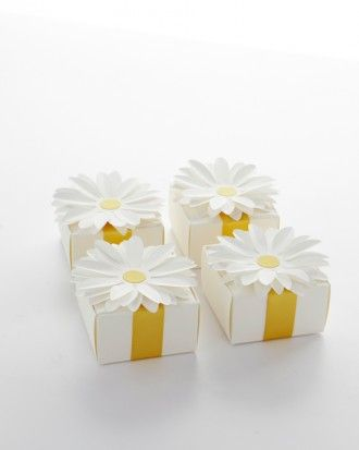 """""""Sweet Goodbyes"""" Send guests home with candy-filled boxes accented with a paper flower."""