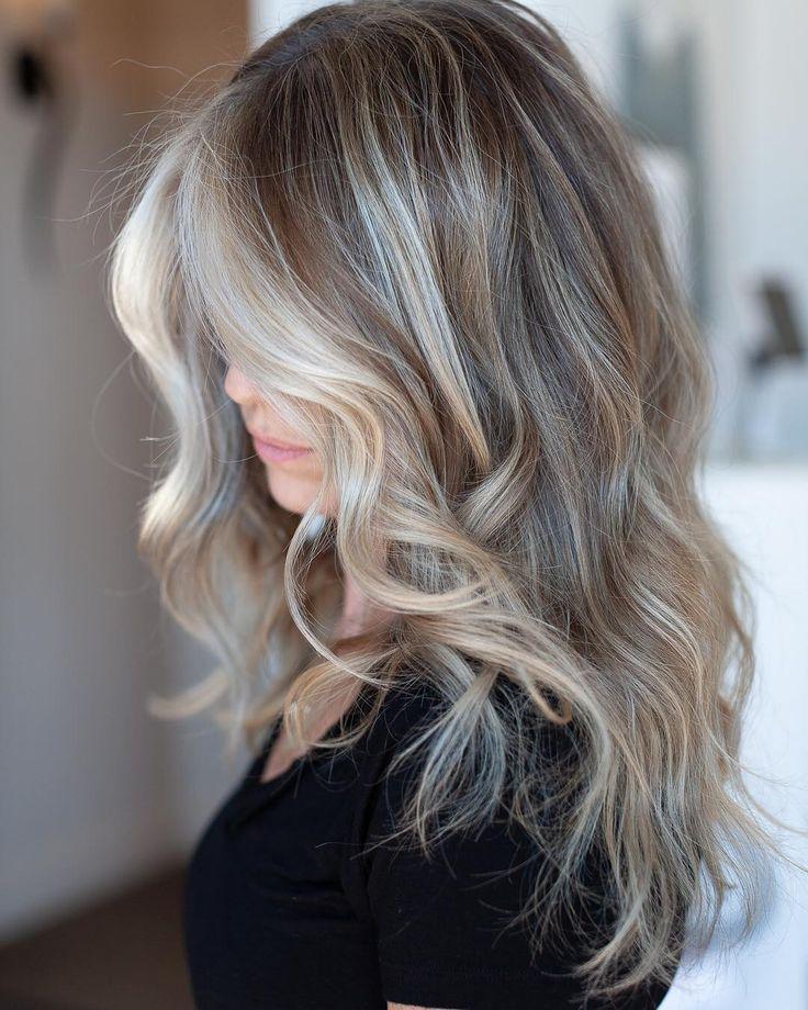 If you're stuck between blonde or dark colored hair, try mushroom blonde hair this summer. Image credit: @laci.mane #mushroomblonde #mushroomblondehair #hair #haircut #summerhair #summerhairstyle #summer #summerfashion #beauty