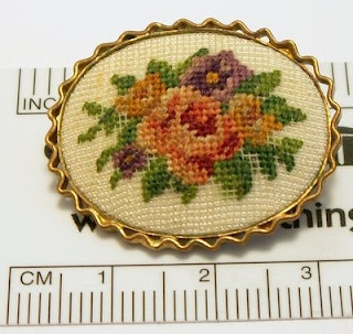 Imagine having the patience to do such tiny petit points as in this vintage embroidered brooch. (And imagine knowing how cheap it would one day be sold...)