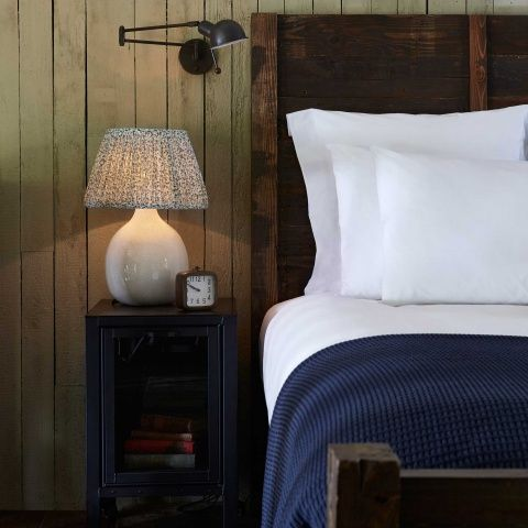 <p><span>The Reade was designed for Soho House Chicago and is now used everywhere from Babington to Soho Farmhouse, due to its versatility and classic design. With a nod to 1950s studio wall lights, it combines Mid Century style with modern functionality and is ideal for a bedside or reading corner.</span></p> <p>• Adjustable, wall-mounted reading light in antique brass finish<br />• Hinged arm and pivoting shade allow light to be directed<br />• Frosted glass disc...