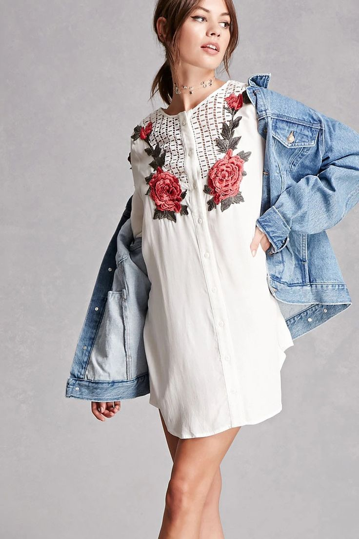 A woven tunic featuring embroidered floral appliques on the front, crochet-paneled yoke, 3/4 buttoned cuff sleeves, and a buttoned placket. This is an independent brand and not a Forever 21 branded item.