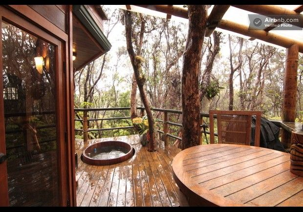 Treehouse at Kilauea Volcano Hawaii  Suspended in ohio trees near an active volcano, this bi-level treehouse offers inhabitants a bird-watching soak in an outdoor cedar hot tub.