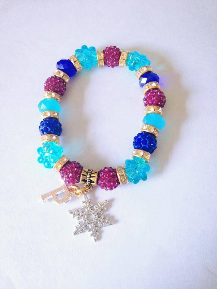 this gorgeous bracelet inspired by Disneys film frozen is based on the character Anna , the golds pinks and purples match perfectly with the characters clothing it's a must for any frozen fan.