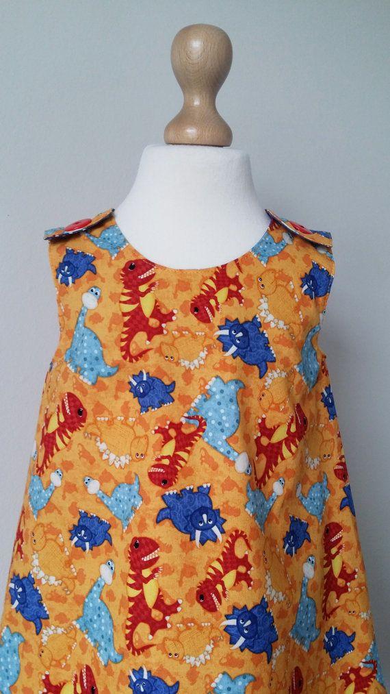 Little girls dinosaur dress, dino pinafore dress, dinosaur party, kids clothing, uk