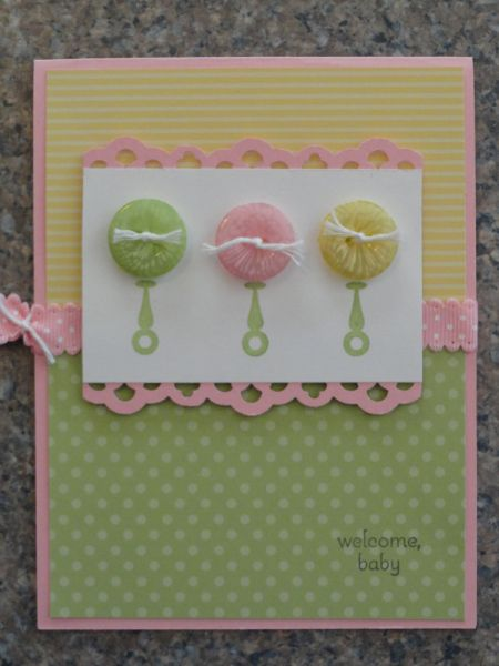 Baby rattle buttons card