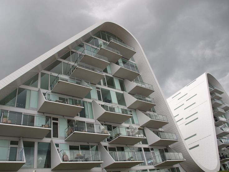 Curvy architecture at The Wave in Vejle, Denmark, by Henning Larsen Architects.