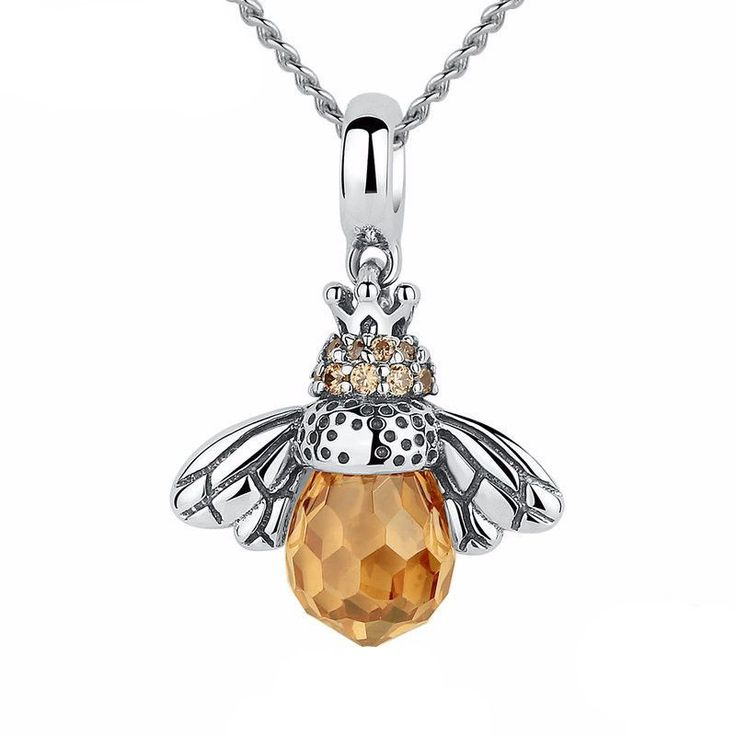 Start a Buzz with this delicately crafted Honey Bee Pendant. Made of genuine Sterling Silver, Each lovely pendant is adorned with stunning hand cut Honey colored crystals. Each pendant comes with a 17