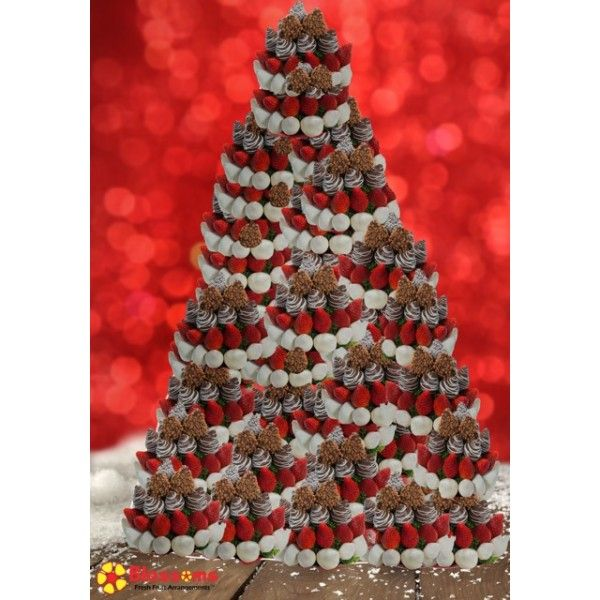 Christmas Blossoms Fruit Bouquet Tower Are you looking for that spectacular centerpiece that is sure to wow all of your guests? This tower was designed specifically for you! Perfect for any wedding, corporate event, party and gathering. Stand out and let your party be the talk all year!   Customization is available. Advanced notice required. Please note picture depicts the large tower.
