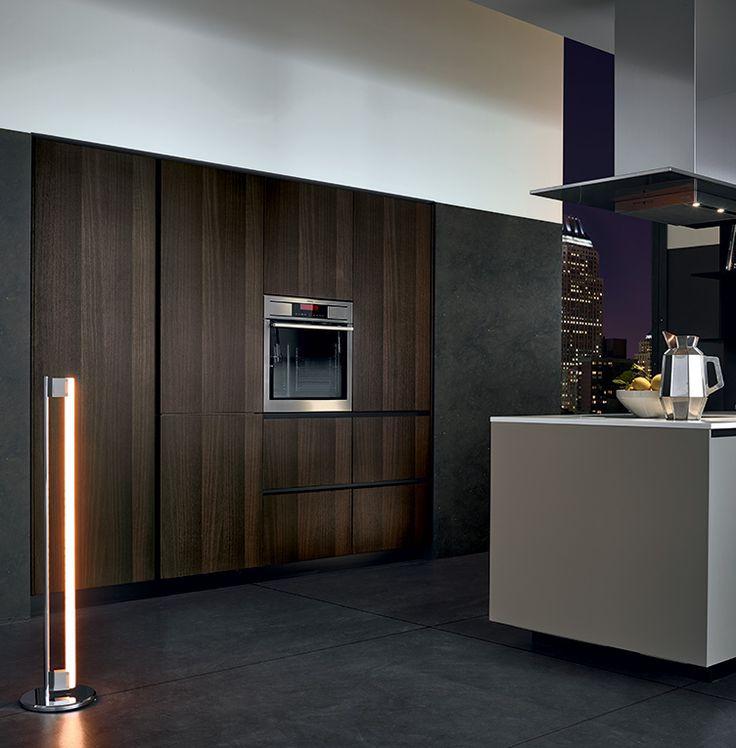 Varenna_Alea kitchen with creta embossed lacquered base units, worktop in superwhite micro-blasted quartzite. Tall units in spessart oak.