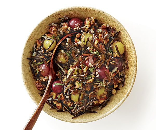 Wild Rice with Roasted Grapes, Pecans, and Sage 1 cup wild rice Kosher salt 2 cups seedless grapes, preferably a mix of colors 1 Tbs. balsamic glaze 2 Tbs. unsalted butter 1 medium shallot, finely chopped (1/4 cup) 1 cup pecans, toasted and coarsely chopped 1 Tbs. pure maple syrup 2 tsp. chopped fresh sage 1 Tbs. fresh lemon juice 1/2 tsp. freshly ground black pepper