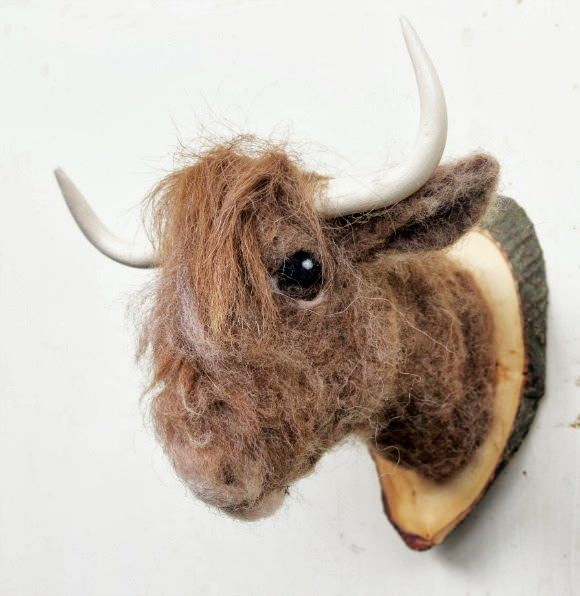 Heheee, cute. Needle-Felted Highlander Cow Head Mount (from faux fauna on etsy) - fun for a kid's room!