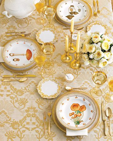 #WOW #TableSetting #gold    Rich gold is the unifying theme here. Whether dusted on a plate rim for a contemporary vibe, woven into a lacy border for a vintage effect, or encircling an oversize mushroom in a note of pure whimsy, it elegantly brings these wildly different table mates together for an affair to remember.