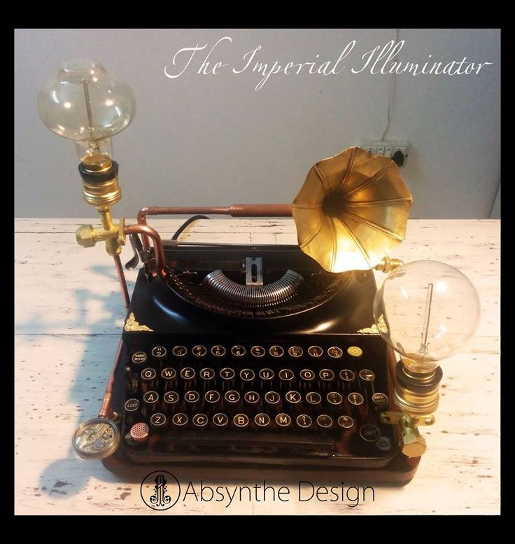 A 1924 #typewriter painstakingly restored & repurposed as an eclectic desk #lamp, complete with handmade incandescent bulbs. #absynthedesign