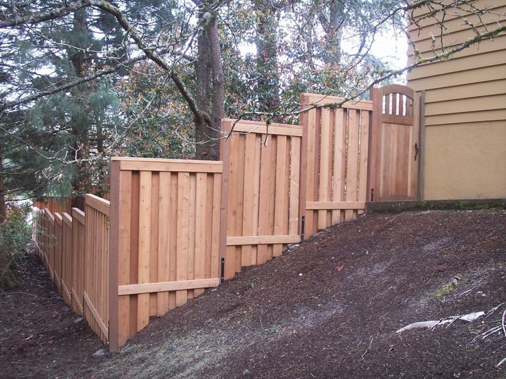 stepped sloped fence   wood fence installation