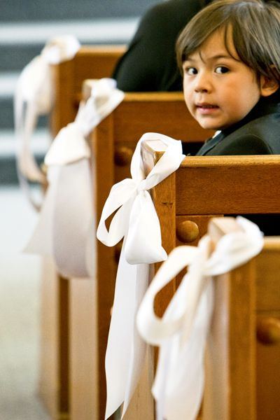 Simple white ribbon bow church decor,   must be double sided satin & wide.  You  could add greenery or baby's breath