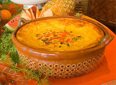 Corn Pudding - This delicate soufflélike dish, the Mexican counterpart to the spoon bread of the American South, is invariably the most popular dish on the Hacienda Sunday Brunch Buffet. It is especially good served with grilled meats, ham, or turkey in mole.