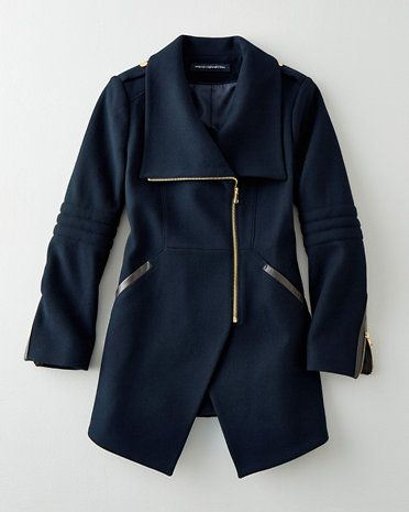 There are lots of little reasons we think this cutaway coat by French Connection is a cut above — namely, the leather accents at the pockets, the shiny gold zippers down the front and sleeves, and the gleaming faux snaps on the epaulettes.