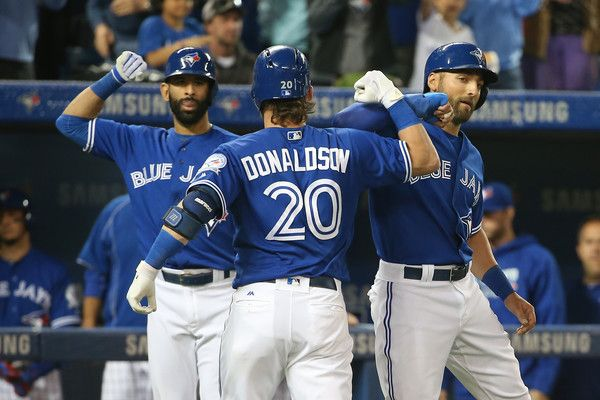 Josh Donaldson Photos - Josh Donaldson #20 of the Toronto Blue Jays is congratulated by Kevin Pillar #11 and Jose Bautista #19 after hitting a three-run home run in the second inning during MLB game action against the Oakland Athletics on April 23, 2016 at Rogers Centre in Toronto, Ontario, Canada. - Oakland Athletics v Toronto Blue Jays